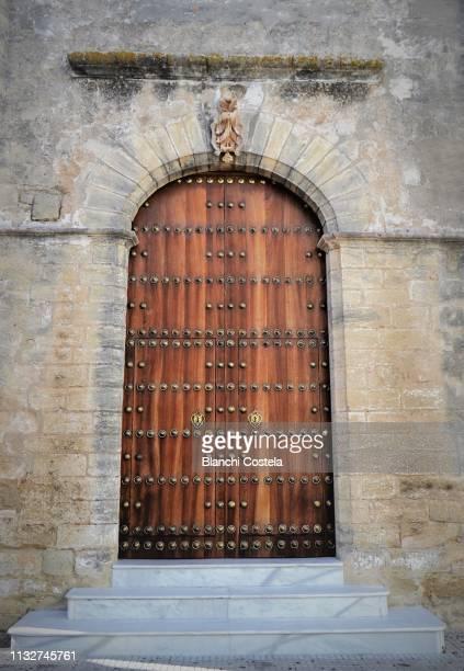 Old wooden door in the Church in Vejer de La Frontera