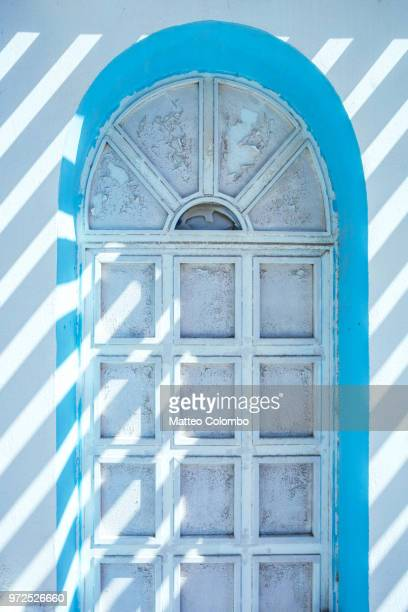 Old wooden door with blue arch, Santorini, Greece