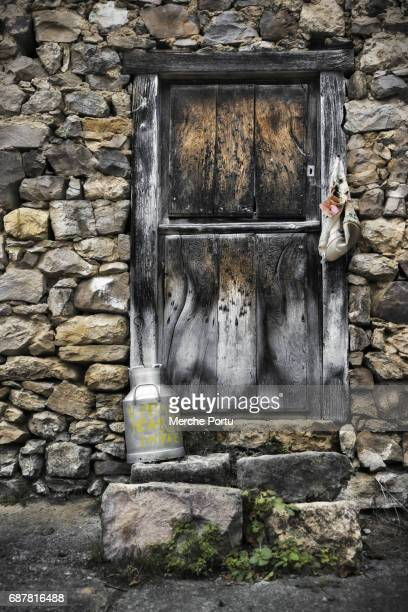 old wooden door with stone facade - milk maid stock photos and pictures
