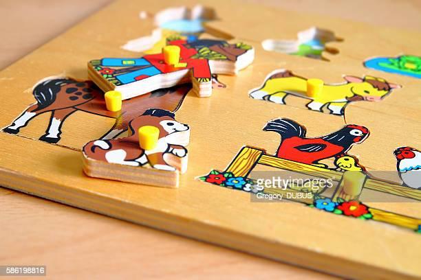 Old wooden flat shape sorter children's toy close-up selective focus