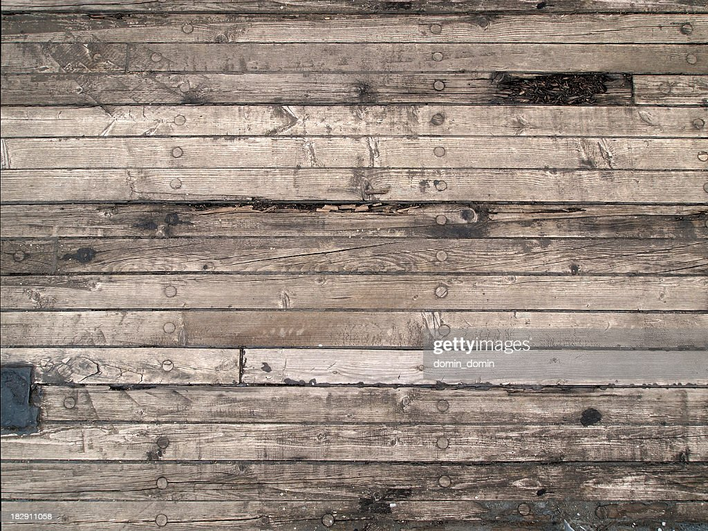 Old wooden floor of the sailing boat, with scratches, cracks : Stock Photo
