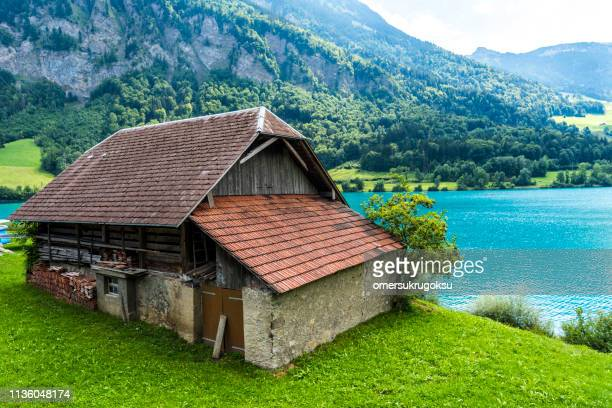 old wooden house and nature landscape in obwalden canton in switzerland - schwyz stock pictures, royalty-free photos & images