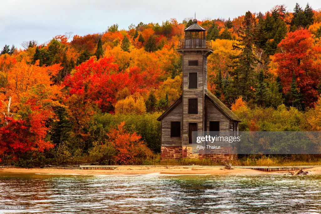 Old wooden lighthouse next to Lake Superior, Grand Island, Upper Peninsula, Michigan, USA : Stock Photo