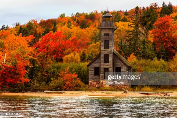 old wooden lighthouse next to lake superior, grand island, upper peninsula, michigan, usa - michigan stock pictures, royalty-free photos & images