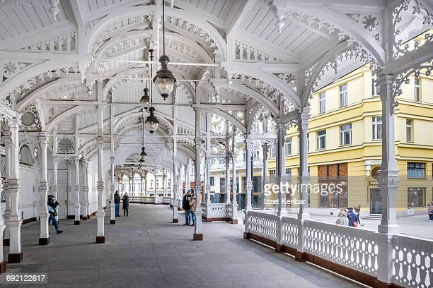 old wooden market colonnade and elegant houses - karlovy vary stock pictures, royalty-free photos & images