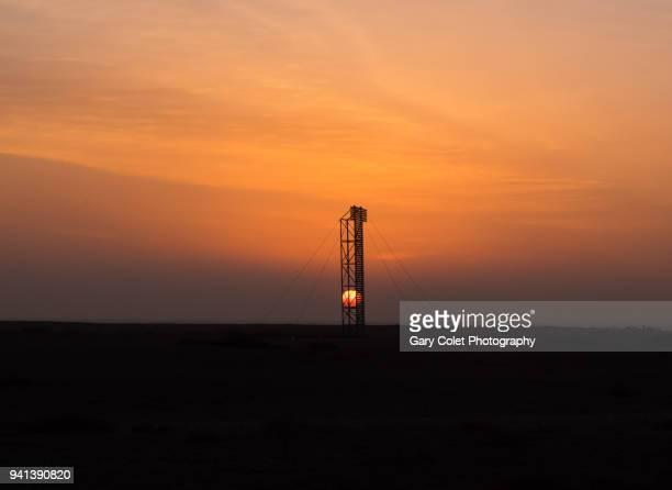 Old wooden navigation tower at sunrise