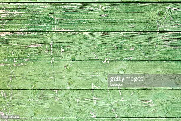 Old wooden panels with uneven green paint