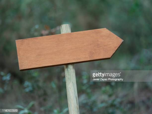 old wooden sign at forest - road sign board stock pictures, royalty-free photos & images