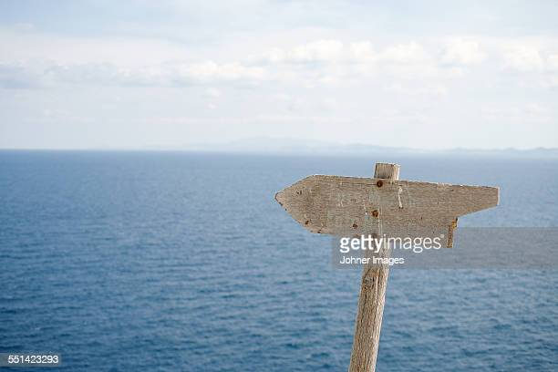Old wooden sign at sea
