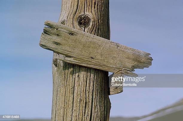 Old wooden sign post