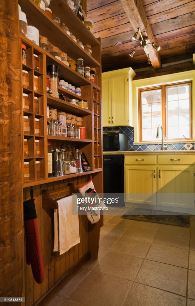 Old Wooden Spice Rack And Yellow Cabinets Stock Photo Getty Images