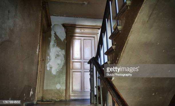 old wooden staircase in an old residential building in berlin, germany - abandoned stock pictures, royalty-free photos & images