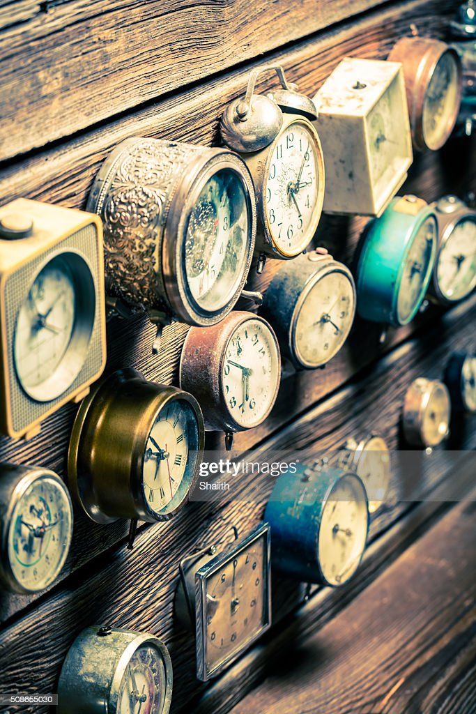 Old wooden wall with clocks : Stock Photo