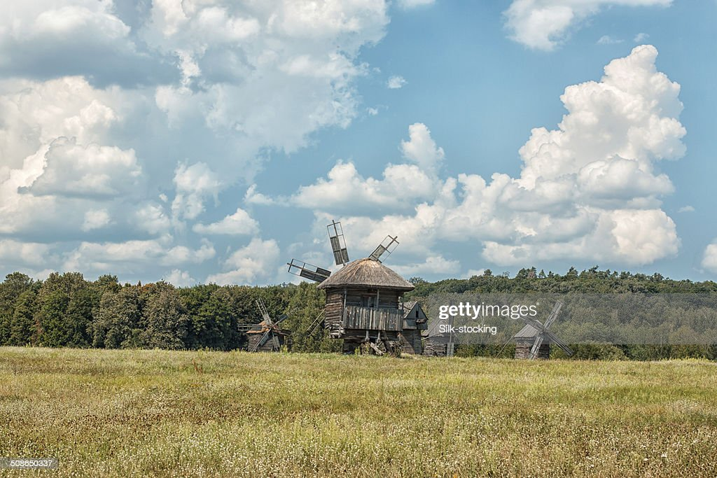 Old wooden windmills on the field. : Stock Photo