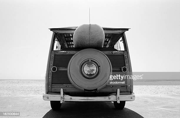 old  woodie station wagon with surfboard - breaking wave stock pictures, royalty-free photos & images