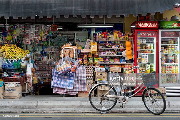 Old world charm of Little India Singapore with its traditional grocers stocked with provisions along alleys with bicycles August 2014