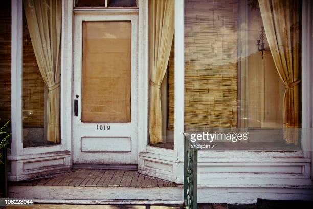 old worn store front boarded up - abandoned stock pictures, royalty-free photos & images