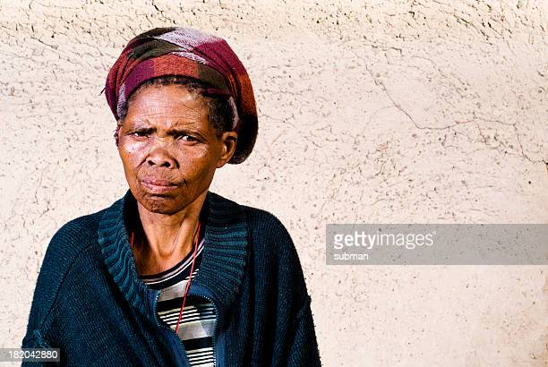 Old Xhosa woman infront of house