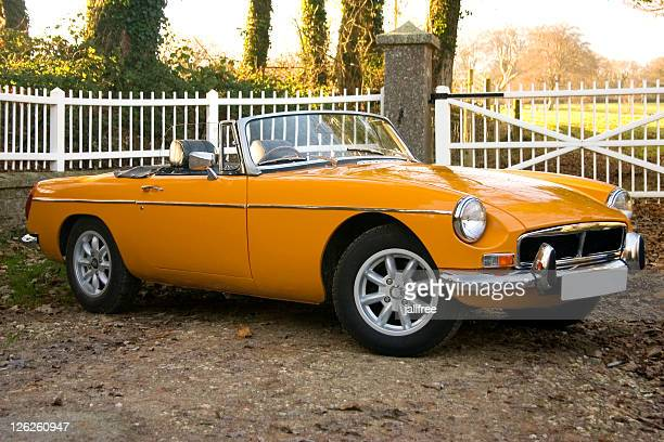old yellow 1970's classic british sports cars - 1970s muscle cars stock pictures, royalty-free photos & images