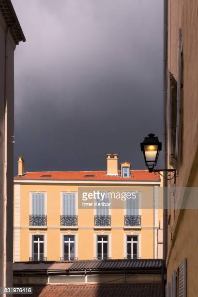 Old yellow building and gray clouds  at Antibes old town, Alpes Maritimes , France