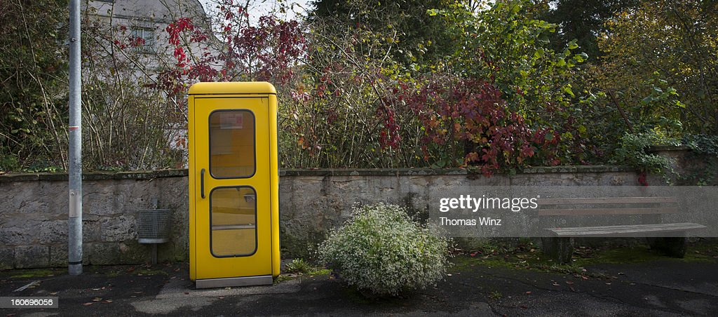 Old Yellow Phone Booth : Stock Photo