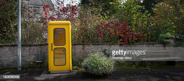 old yellow phone booth - telephone booth stock pictures, royalty-free photos & images