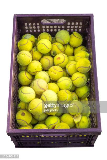 old yellow tennis balls - tennis ball stock pictures, royalty-free photos & images