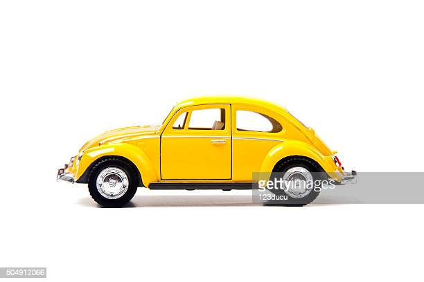 old yellow volkswagen beetle - volkswagen stock pictures, royalty-free photos & images
