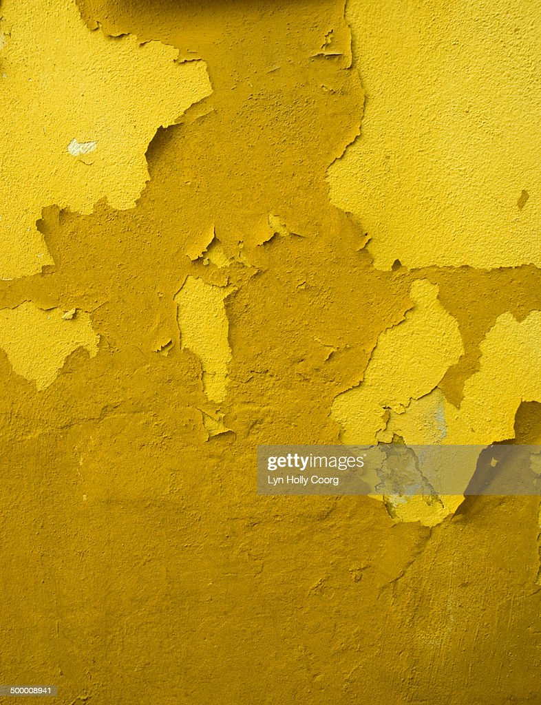 Old yellow wall with peeling paint : Stock Photo