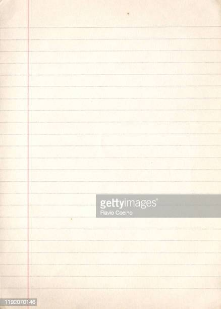 old yellowish lined paper college ruled background - lined paper stock pictures, royalty-free photos & images