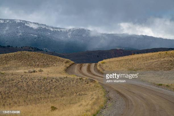 old yellowstone trail road after storm - khaki stock pictures, royalty-free photos & images