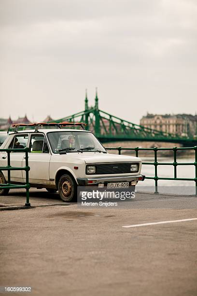 old zastava car at donau river - merten snijders stockfoto's en -beelden