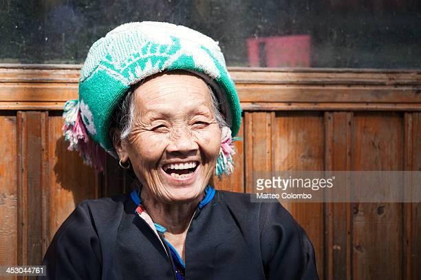 Old Zhuang minority woman smiling