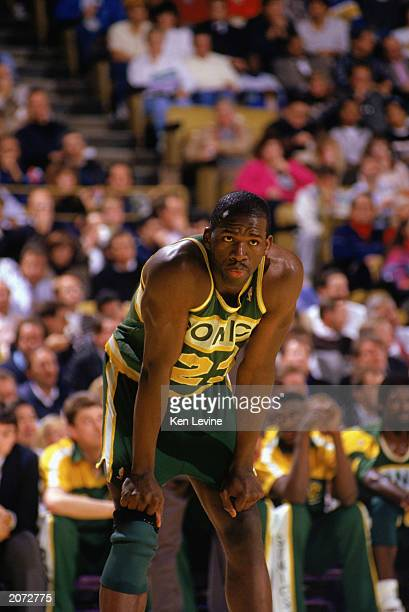 Olden Polynice of the Seattle Supersonics looks on during a game against the Los Angeles Lakers in the 19891990 NBA season at the Great Western Forum...