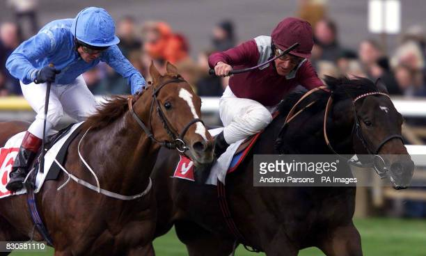 Olden Times with jockey Pat Eddery hold off a challenge from Sunny Glenn and jockey Jason Weaver to win the Feilden Stakes at Newmarket races
