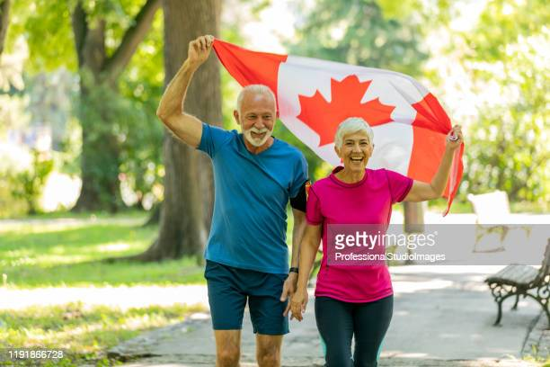 older american patriots with the canadian flag - canada day stock pictures, royalty-free photos & images