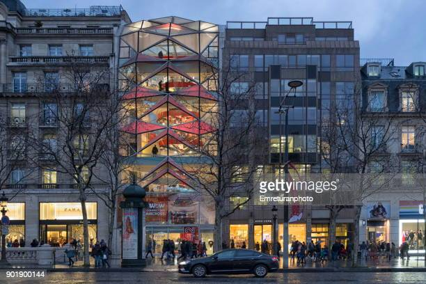 older and modern new buildings side by side in champs elysees,paris. - emreturanphoto stock pictures, royalty-free photos & images
