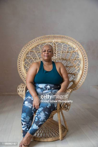 older black woman doing yoga - ambassador stock pictures, royalty-free photos & images