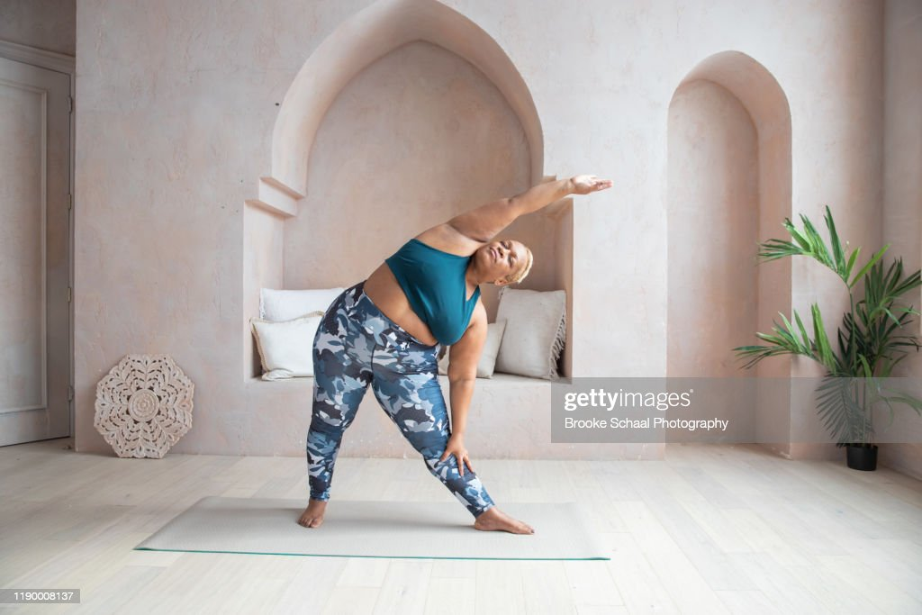 Older Black woman doing yoga : Stock Photo