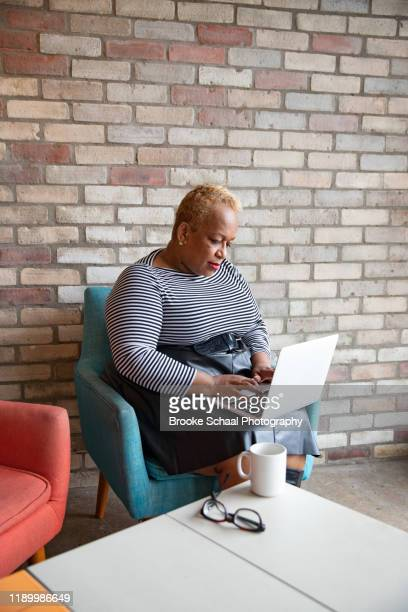 older black woman in a cafe - chesty love stock pictures, royalty-free photos & images
