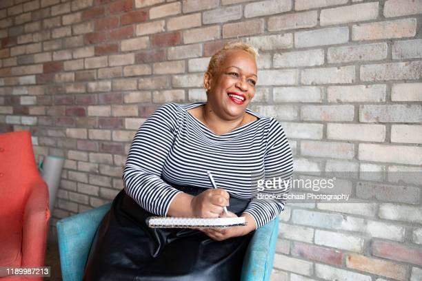older black woman in a cafe - showus stockfoto's en -beelden