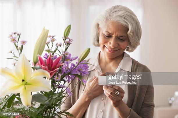 Older Black woman receiving bouquet of flowers