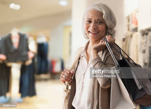 Older Black woman shopping in store