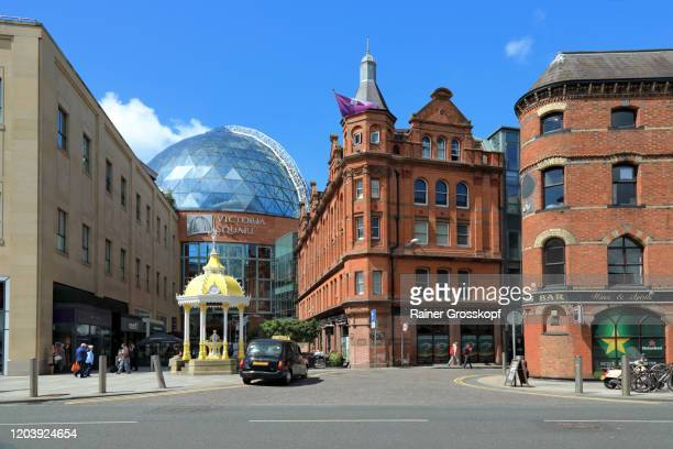 older brick buildings in contrast with a modern building with a glass dome - rainer grosskopf stock pictures, royalty-free photos & images