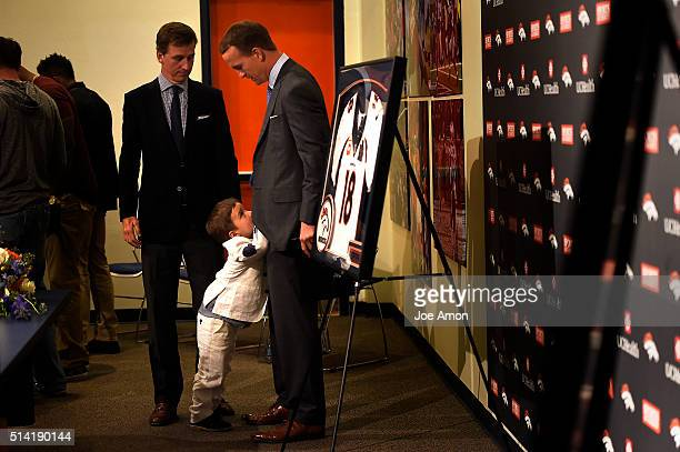 Older brother Cooper Manning with Denver Broncos quarterback Peyton Manning and his 4 year old son Marshall after a press conference to announce his...
