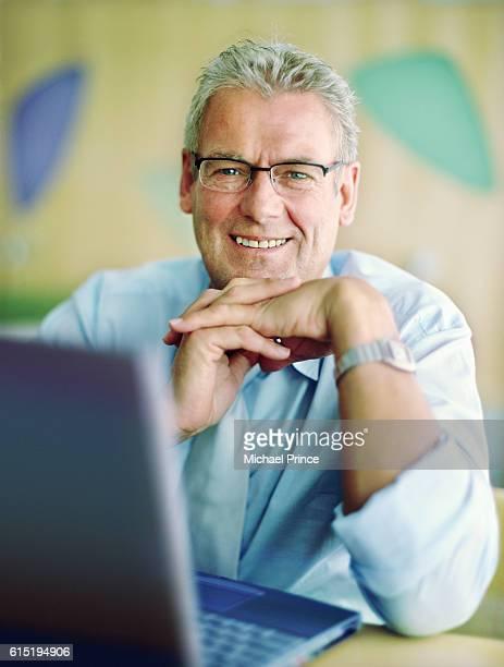 Older Businessman at Laptop