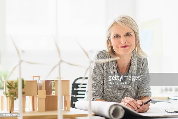 Older Caucasian architect sitting in office