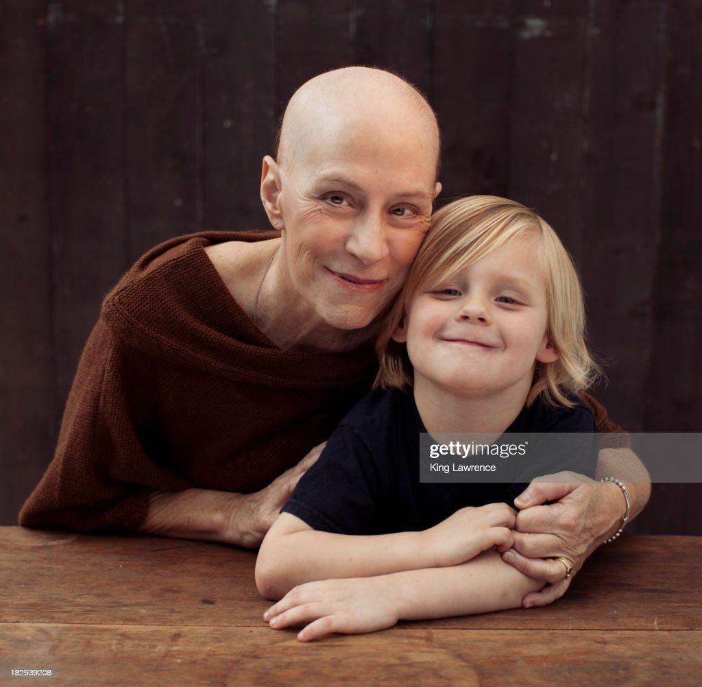 Older Caucasian cancer survivor with grandson : Stock Photo