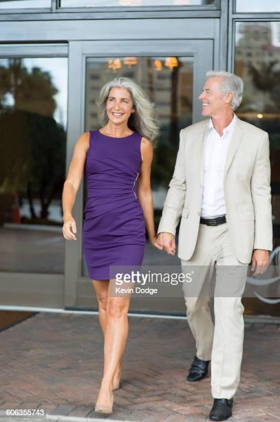 Older Caucasian couple walking holding hands