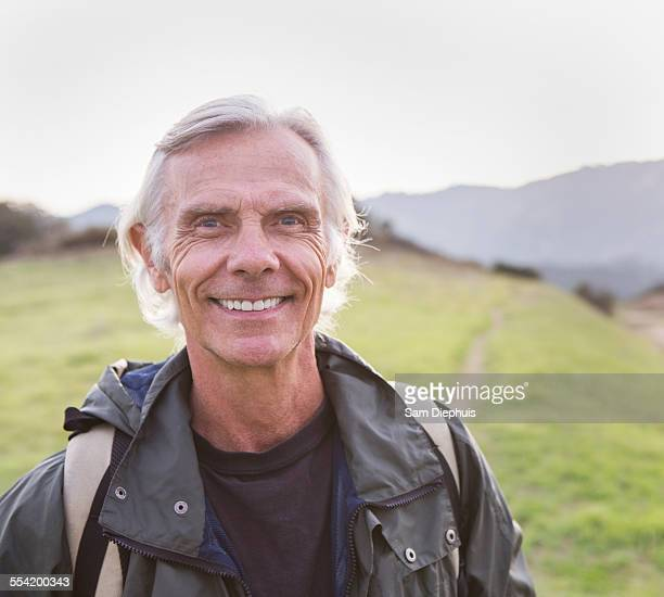 older caucasian man walking on dirt trail - environmental issues imagens e fotografias de stock
